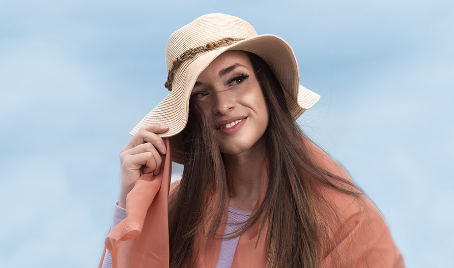 Picture of a girl outdoors with a sun hat.